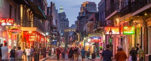Pubs are alight with neon lights on New Oreleans famed Bourbon Street