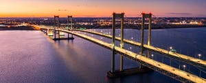 The Delaware Memorial Bridge crosses the Delaware River to connect New Jersey and Delaware.