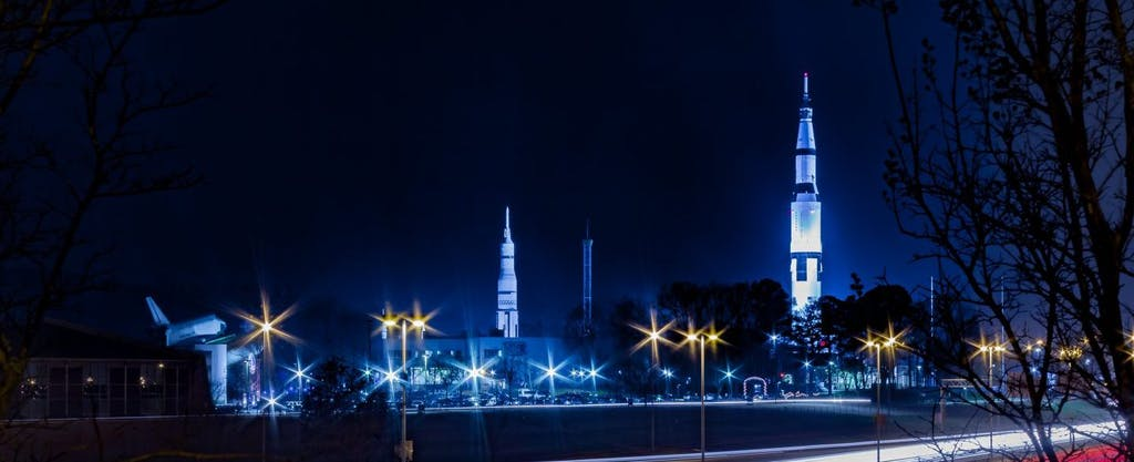 A rocket sits on a launch pad at night at the U.S. Space and Rocket Center in Huntsville, Alabama.