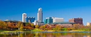 The Omaha, Nebraska skyline in Autumn. Omaha residents, like all Nebraska residents, must consider if they have to file a Nebraska state tax return.