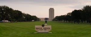The State Capital grounds in Bismark, North Dakota are home to the states legislature, which establishes North Dakota state tax laws.