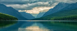 A scenic view of Glacier National Park in Montana illustrates the state's nickname Big Sky Country. State residents may have to file a Montana income tax return.