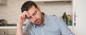 Frustrated man calculating bills