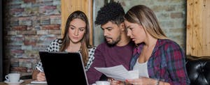 Young group of people researching student loans