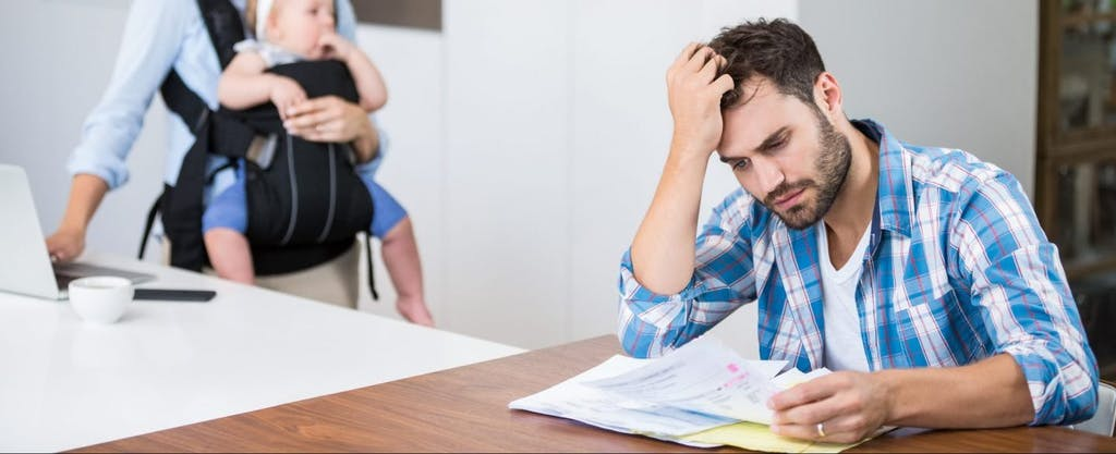 Frustrated couple reading documents and wondering how they can avoid a 401(k) tax on the withdrawal they made from their retirement account