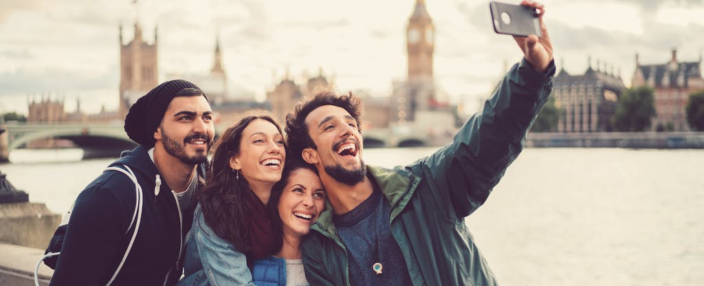 Group of friends taking selfie in London