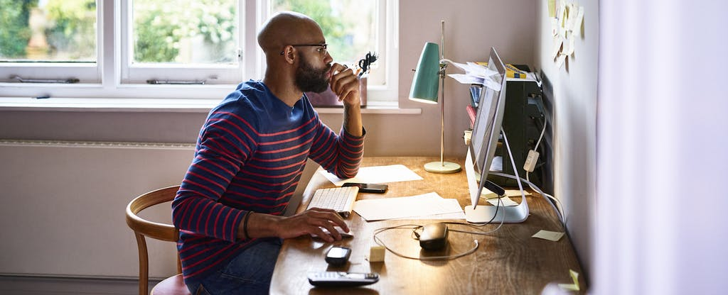 Man using computer in his home office