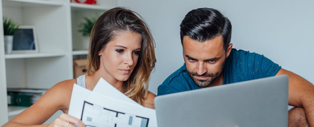 Young couple is using laptop pc