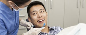Man smiling at the dentist before his clearning