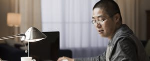 Man sitting at his desk, checking his mail