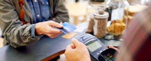 Shot of a customer paying for their order with a credit card in a cafe