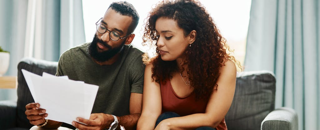 Young couple going over their finances together at home