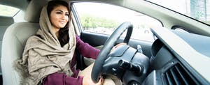 Young woman driving car in the city