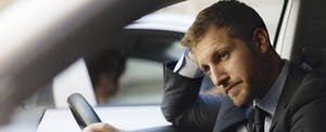 Man driving his car, looking stressed