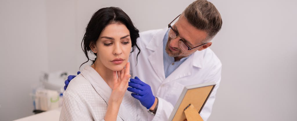 Woman talking with doctor about plastic surgery financing