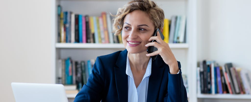 Businesswoman talking on phone at the office