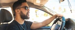 Man driving a car and singing