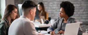 Couple in a meeting with a woman at a bank