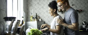 Couple cooking at home together