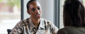 Female soldier talks with a financial counselor about an AER loan