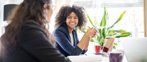 Woman in meeting with coworker at start up office