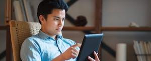 Man looking up NJ homestead rebate on tablet