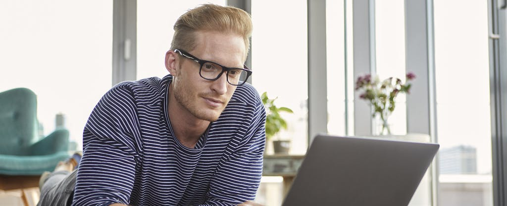 Man with glasses looking up why credcoisonhiscreditreport