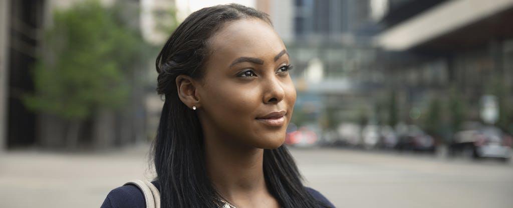 Thoughtful woman considering Prosper healthcare lending