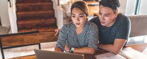 Woman reviewing her loan options with her partner, considering an Omni military loan