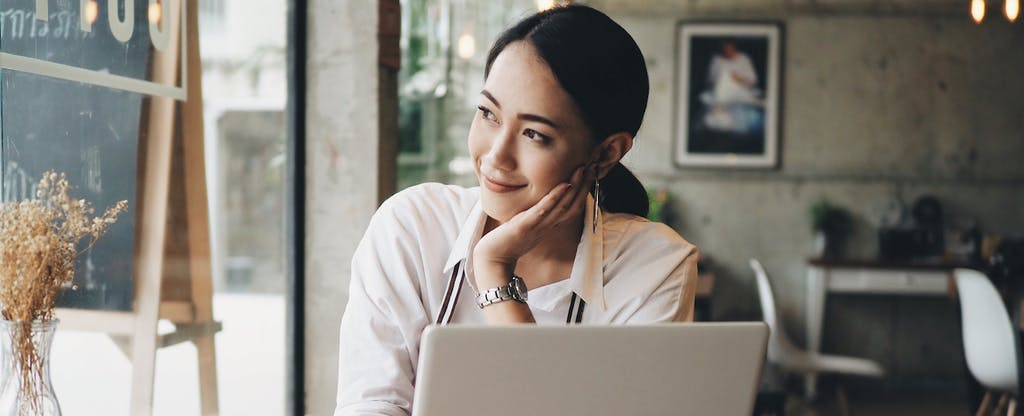Woman on laptop, looking up the 2020 federal tax brackets
