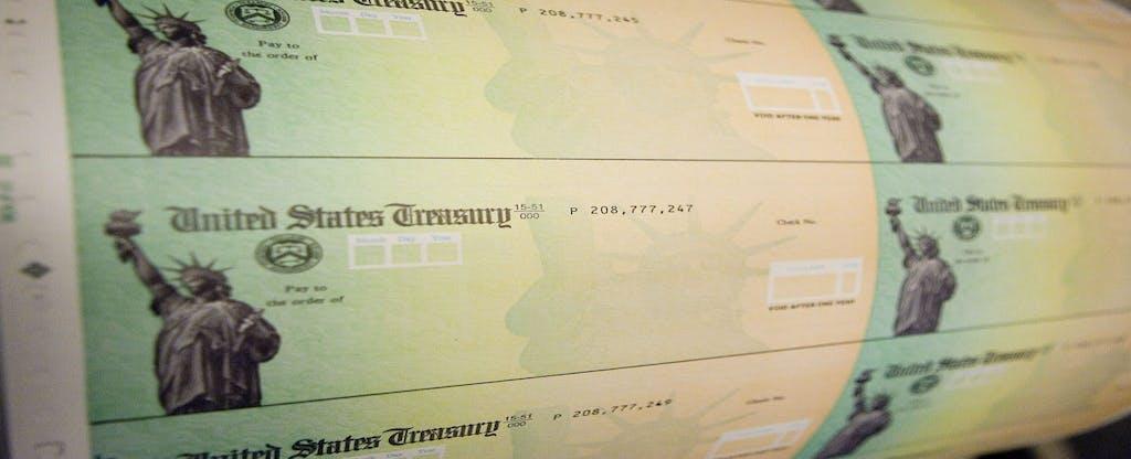Economic stimulus checks are prepared for printing.