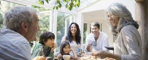 Multi-generation family talks in kitchen