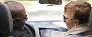 Rear view of couple traveling in car