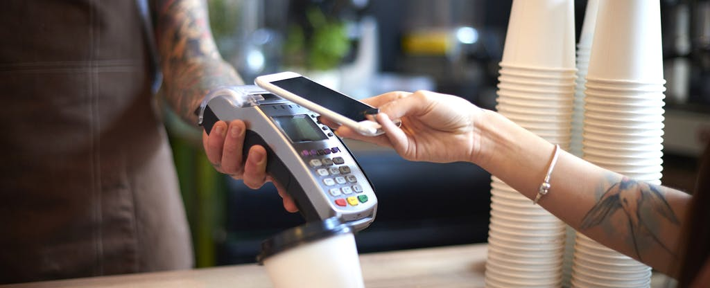 Customer making mobile payment with phone