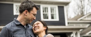 Happy couple in front of their new South Carolina home