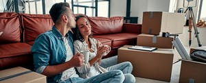 couple in new home with boxes