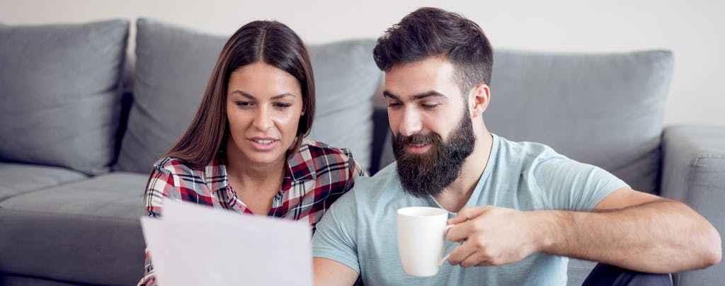 Couple looking at paperwork, considering a White Rock loan