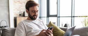 Man looking at his mobile phone to check the Klover app