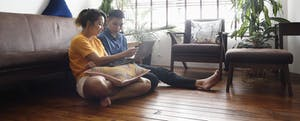 Couple on living room floor discussing future